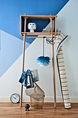 Ornaments on wooden shelving against blue wall