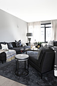 Sofa set in conservatory in shades of grey