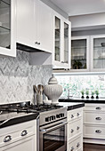 White fitted kitchen with black worksurface