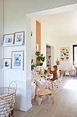 Open doorway leading into playroom with child sitting at sideboard