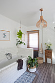 Wooden floor and subway tiles in bathroom in natural shades