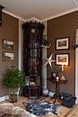 Dark tiled stove in corner of festively decorated living room