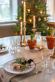 Dining table festively decorated with candlesticks and hyacinths