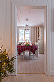 View into Scandinavian dining room with Christmas tree in foreground