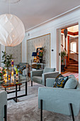 Pale blue armchairs in elegant living room with Christmas decorations
