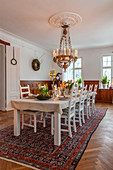 Festively set table in dining room with chandelier