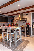 Tall table and bar stools in modern country-house kitchen