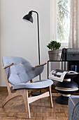 Scandinavian-style armchair and designer side table