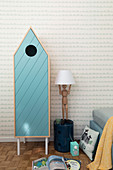 House-shaped wardrobe and table lamp on artists' mannequin
