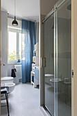 Modern bathroom in blue, grey and white