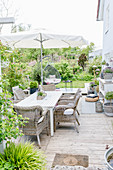 Furniture, outdoor rugs, hanging chair and ornaments on terrace
