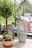 Terrace with lanterns, olive tree and hanging chair