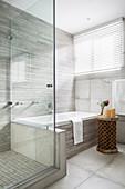 Shower and bathtub in grey, modern bathroom