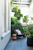Black hammock chair on covered porch
