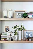 Vases, photos, books and other decorative items on shelves