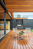 Spacious wooden terrace with outdoor kitchen