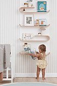 Curved wooden shelf for pictures and books in children's rooms