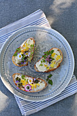 White bread with butter and edible flowers