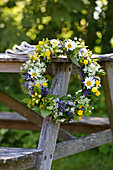 Pretty wildflower wreath with ox-eye daisies, buttercups and ground elder