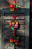 Small willow wreaths decorated with colourful felt flowers and felt hearts