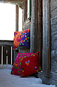 Colourful cushions decorated with various ethnic felt motifs