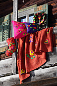 Wreath, cushions, blanket and Christmas stocking decorated with ethnic felt motifs