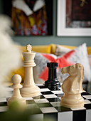 Chess pieces on chequered table