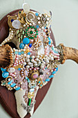 Animal skull richly decorated with beads and brooches