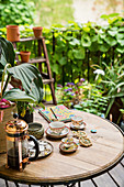 Vintage-style coffee set on balcony table of period apartment