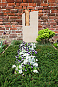 Grave design with horned violets and pansies