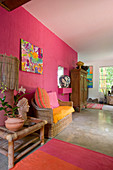 Tropical ambience in living room with hot-pink wall