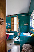 Creative, artistic bathroom in shades of aqua blue