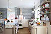 White wainscoting and patterned wallpaper in romantic country-house kitchen