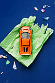 Toy car on green wrapping paper