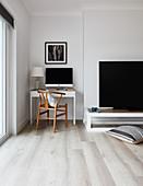 Designer chair at desk in niche in living room