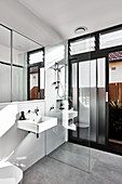 Walk-in shower in modern bathroom with garden access
