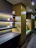 Open bookshelves with indirect lighting