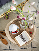 Open book, strawberries and flowers on coffee table