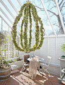 Chandelier covered in leaves in greenhouse