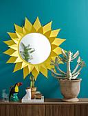 Round mirror with handmade yellow paper sunburst