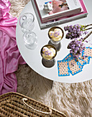 Mirror table and pink throw