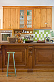 Wooden wall units and counter in country-house kitchen