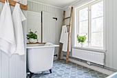 Free-standing bathtub in vintage, country-house-style, Scandinavian bathroom in