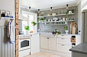 Bright, Scandinavian country-house kitchen in Swedish summer house