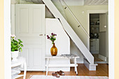 White, wooden, ships' ladder stairs in Swedish country house