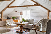 Cosy seating area in converted attic of Swedish house