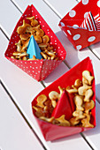 Snacks served in handmade paper boats