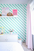Bedroom wall with diagonal white and turquoise stripes