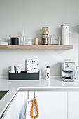 Kitchen utensils on shelves in minimalist, modern kitchen