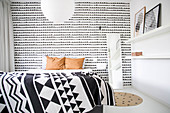 Black-and-white graphic patterns in bedroom